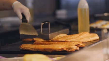 taje : The chef cooks the bread on a hot metal plate for making sandwiches for Breakfast.