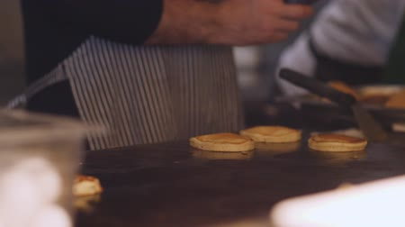 baking dishes : The chef cooks on the stove pancakes