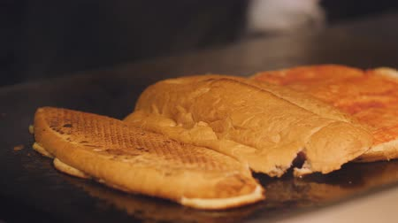 taje : Male cook fry bread on a hot metal plate. Preparation of sandwiches for Breakfast in the hotel. Dostupné videozáznamy