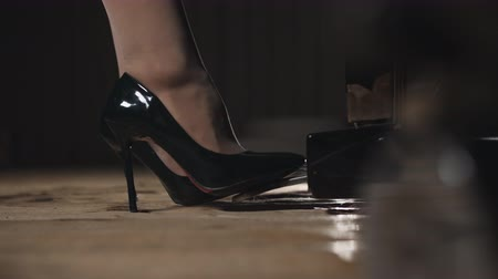 スタッド : Close-up of female legs in shoes pressing on the pedal piano.