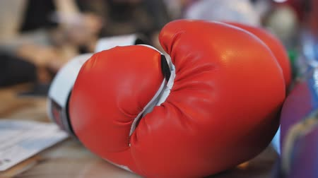 átlyukasztás : Red Boxing glove lay on the table of the judges of a Boxing match.