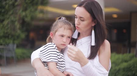 bank : Little girl crying sitting on mother