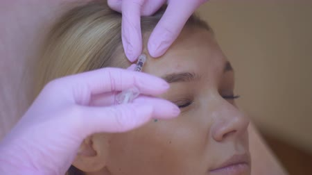 mezoterapia : In the clinic, the cosmetologist performs a procedure to restore the processes in the skin. Biorevitalization