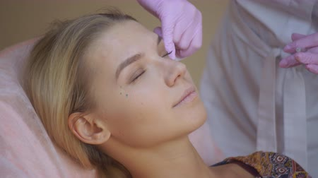 mezoterapia : Professional beautician making face injection in a female skin. A woman gets beauty facial cosmetology procedure.