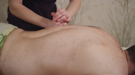 professionalism : Female hands doing professional relaxing massage to a man in the salon, clouse-up. Stock Footage