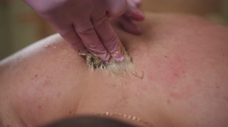 セクシャル : Painful waxing mens back sugaring.