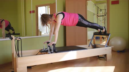 Physical therapy of the body. Studio equipment Pilates.