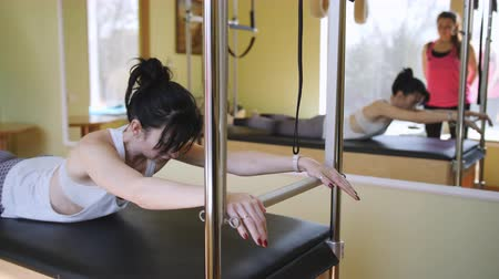Pilates. Classes with a trainer at the gym Pilates on a special simulator.