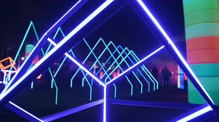 neon lights : Abstract neon glowing shapes as the nightclub decoration outdoors. Stock Footage