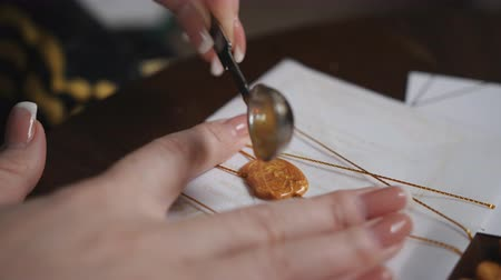 decorador : Stamping Gold Wax Seal onto a white Envelope Stock Footage