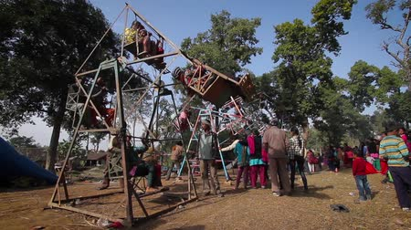 mevcut : Bardia, Nepal - January 16, 2014: Traditional carousel in fairground during Maggy festival in Bardia, Nepal