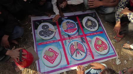 mevcut : Bardia, Nepal - January 16, 2014: Traditional gambling in fairground during Maggy festival in Bardia, Nepal