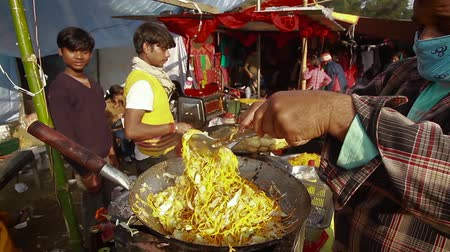 third world : Bardia, Nepal - January 16, 2014: Preparing local food in a fairground Maggy festival in Bardia, Nepal Stock Footage