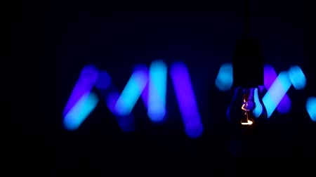aydınlatma : incandescent lamp against the background of concert, dance music, lighting effects, light bulb closeup