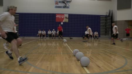 low lighting : Dodgeball players picking up balls at the start of the game.  Filmed at 60fps