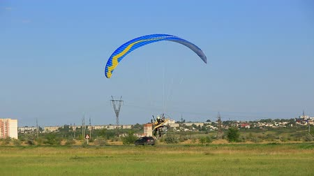 hang gliding : SYZRAN, RUSSIA, JULY 27, 2015: paraglider flies low over the ground, summer