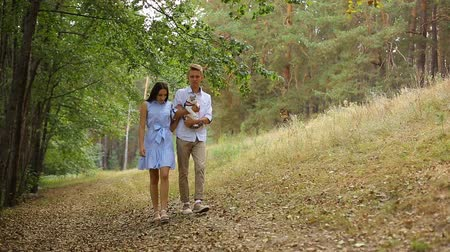 adrenalin : young couple walking in the woods on the track with his cat.