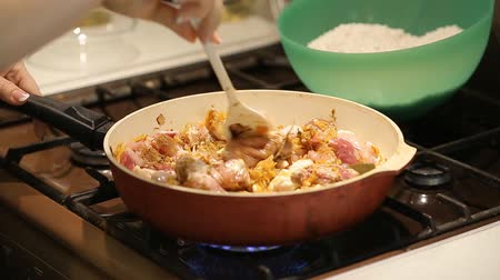 frypan : housewife puts chicken and beef in a pan with vegetables for cooking pilaf Stock Footage