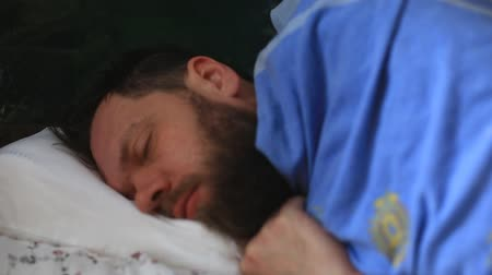 bearded man asleep on an orthopedic pillow Stock Footage