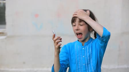 crashed : Broken glass screen smartphone in hand of upset girl, white background.