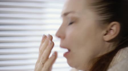 handkerchief : Sick woman sneezing and blowing her nose due to allergy Stock Footage