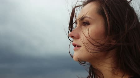 ventoso : Close up portrait of beautiful young woman. wind blowing hair