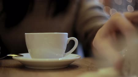 spoons : Girl pours sugar batched in the cup Stock Footage