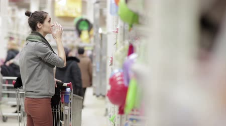 aisles : Girl walking through store with a market cart