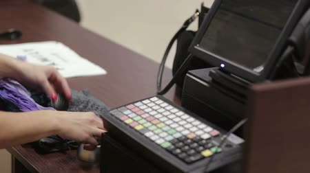 clothing : Cash register in the clothing store. Stock Footage