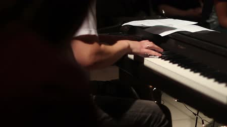 musicians stage : keyboard player playing on electric piano Stock Footage