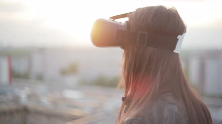 realidade : woman uses a virtual reality glasses on the roof