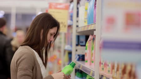 cleaning products : Woman chooses household chemicals in the store Stock Footage