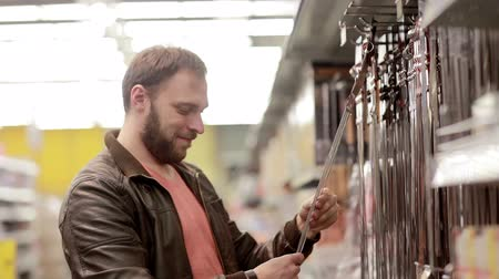aisles : Man chooses subjects  for barbecue or grill Stock Footage