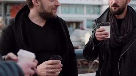 dostluk : Three handsome men with beards having conversation and coffee outside. Slow mo Stok Video