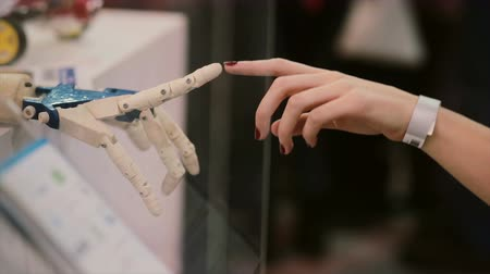 part of clip : Touching hands of human and cyborg or The Creation of cyborg.
