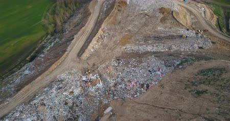 decomposition : Aerial view of the urban dump and waste recycling factory. Copter flying over the big piles of garbage trash.