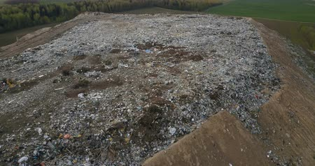 decomposition : Aerial view of the pile of trash. Copter flying over the urban dump outside the city, refuse dirty waste.