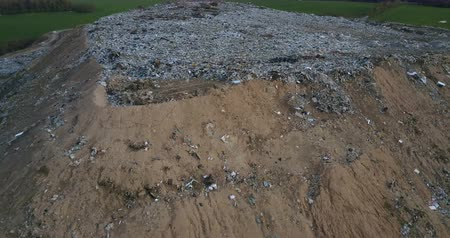 decomposition : Aerial drone shot of the ecological damage. Drone flying around the urban refuse dump. Big piles of garbage trash. Stock Footage