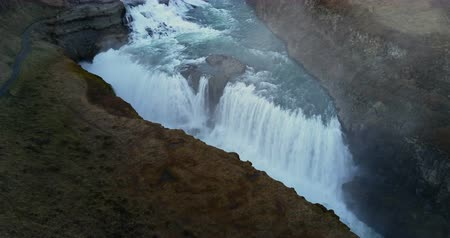 gullfoss : Aerial view of beautiful scenic landscape in Iceland. Powerful waterfall Gullfoss cascades flows down in mountains.