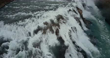 gullfoss : Aerial view of the turbulent flow of water in the cliffs. Copter flying over the powerful waterfall in Iceland.