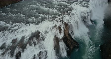 gullfoss : Beautiful wild waterfall Gullfoss from the copter. Aerial view of the turbulent flow in Iceland nature.