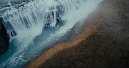 gullfoss : Aerial view of the waterfall Gullfoss in cleft. Copter flying over the valley and turbulent flow in Iceland. Stock Footage