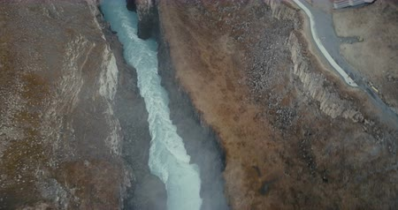 gullfoss : Aerial view of the wild river in mountains crevice. Beautiful waterfall Gullfoss in Iceland, turbulent flow. Stock Footage