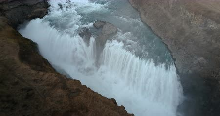 gullfoss : Aerial view of beautiful scenic landscape in Iceland, waterfall Gullfoss on the mountains. Turbulent flow.