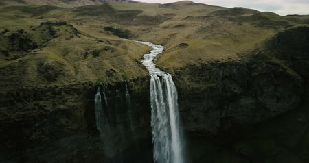 crevice : Aerial view to the mountains river flows through the valley and falls down. Waterfall Seljalandsfoss in Iceland.
