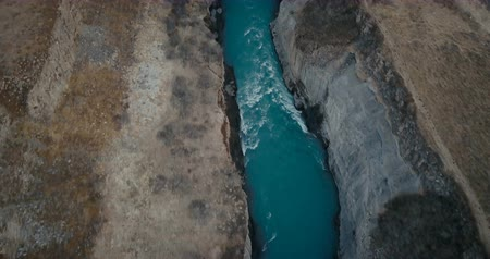 gullfoss : Aerial view of the waterfall Gullfoss in crevice. Copter flying over the valley and turbulent flow of the river in Iceland Stock Footage