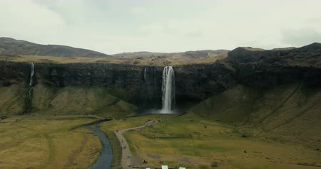 fenda : Aerial view of beautiful scenic landscape in Iceland. Powerful waterfall Seljalandsfoss falls down in mountains.