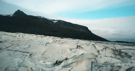 glacier point : Aerial shot of the ice crevices with black volcanic ash. Copter flying over the big glacier Vatnajokull in Iceland. Stock Footage