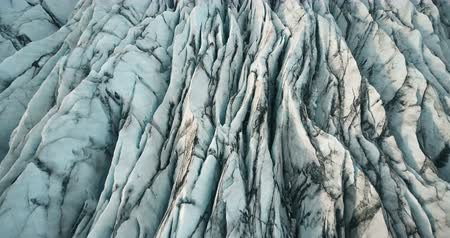 glacier point : Aerial top view of the ridges of white glacier with black ash. Scenic iceberg in national park in Iceland. Stock Footage
