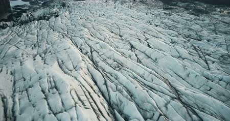 glacier point : Top aerial view of the iceberg in Iceland. Drone flying over the stripes of glacier Vatnajokull with volcanic ash.